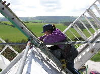 Painting the roof - Photograph : Roger French