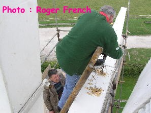 Drilling holes for the bolts - Photo by Roger French